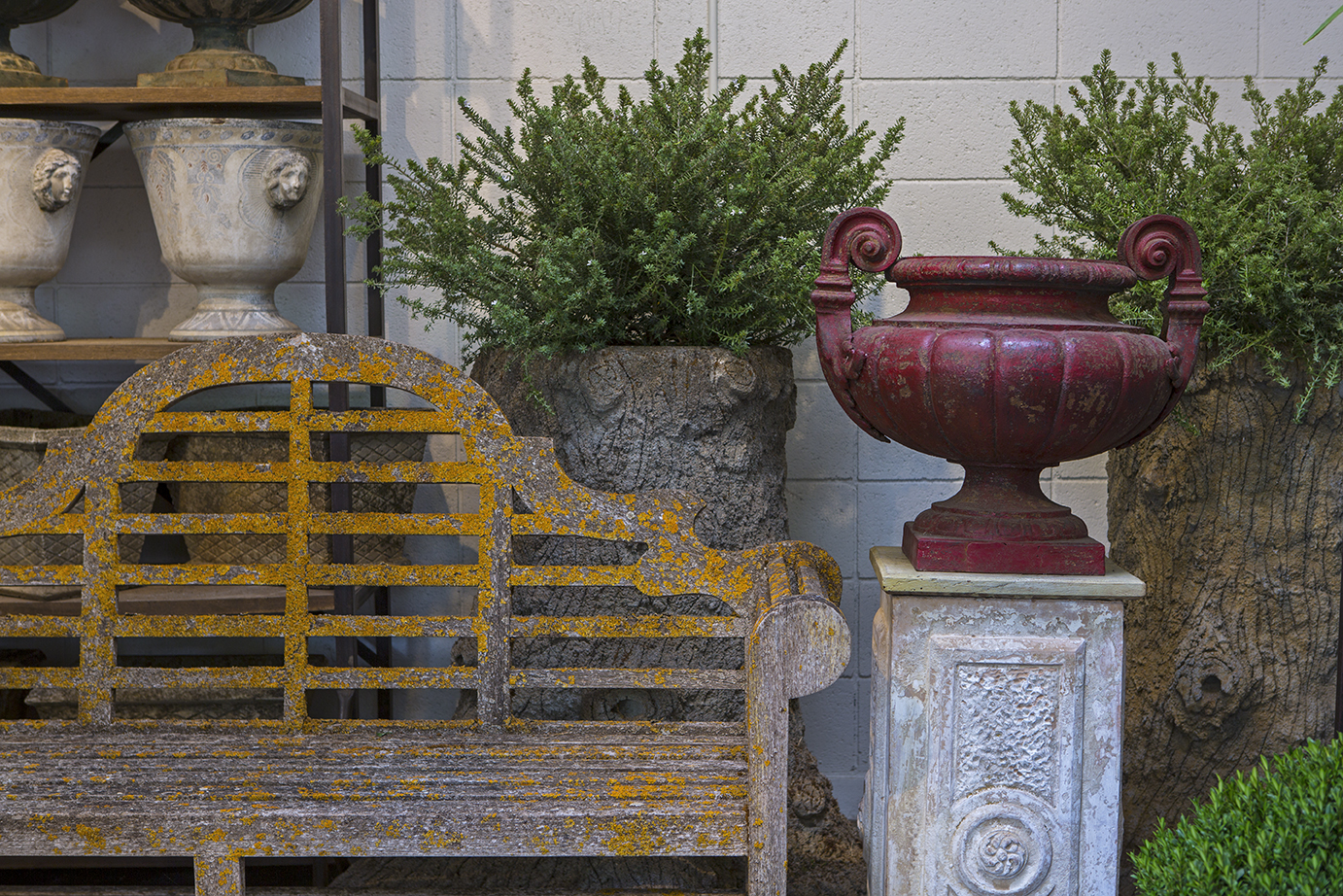 patina bench and iron urn