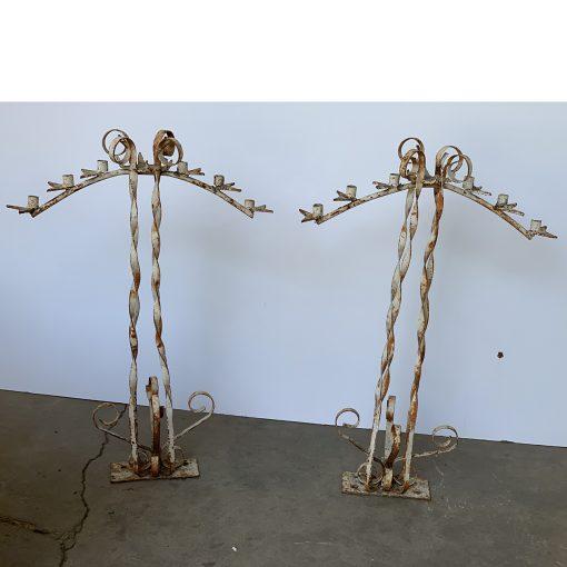 Pair of iron antique candelabras