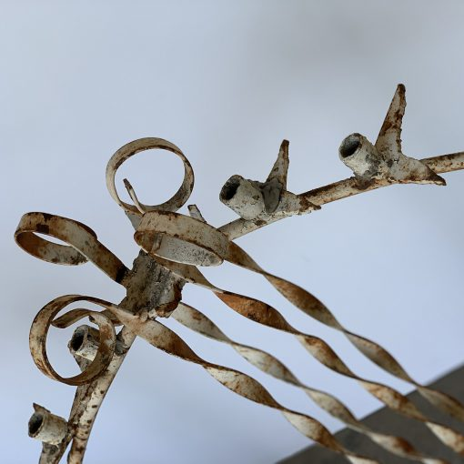 Close detail of antique wrought iron candle holder