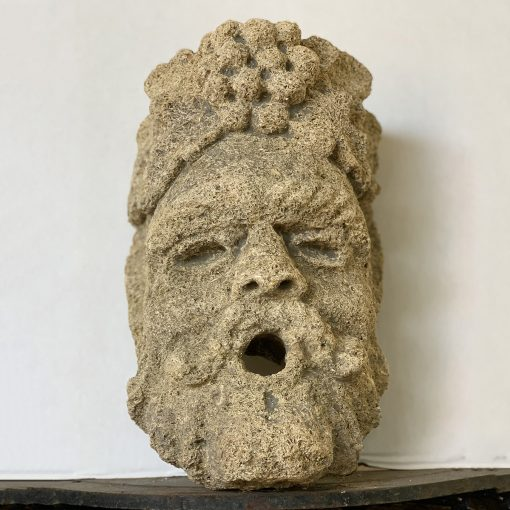 Antique limestone fountain head