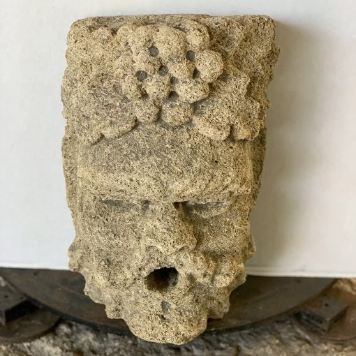 Antique hand-carved limestone fountain head