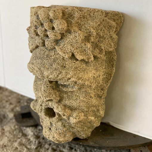 Antique limestone carving right view