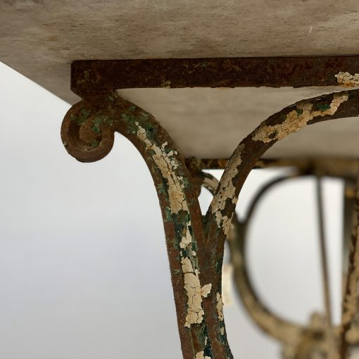 Antique cast iron leg with marble top closeup