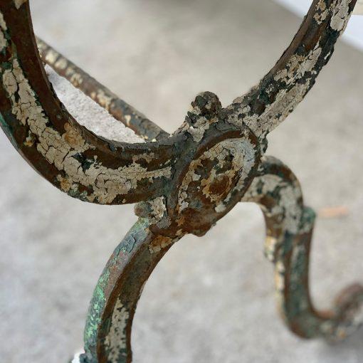 Art Nouveau antique cast iron table leg closeup