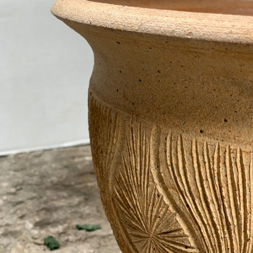 Earthgender midcentury pottery, closeup of sunburst design on teardrop planter