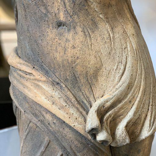 Antique cement angel statue middle torso closeup