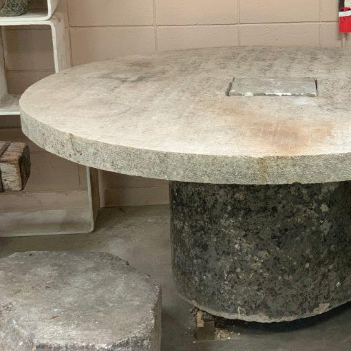 Reclaimed millstone, antique limestone table top left edge