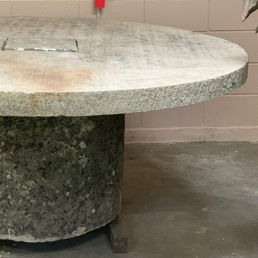 Reclaimed limestone table closeup of antique millstone right top edge