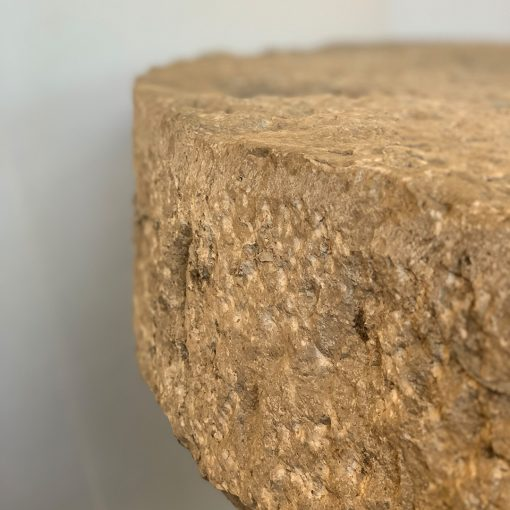 Reclaimed limestone garden table top of antique millstone, left edge