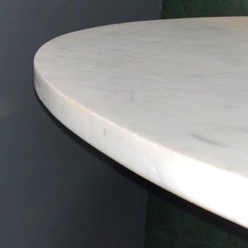Round marble top bistro table edge closeup