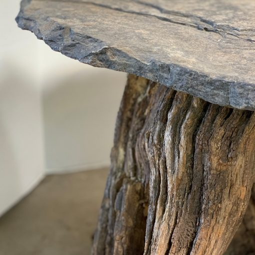 Slate top wood root coffee table, left closeup