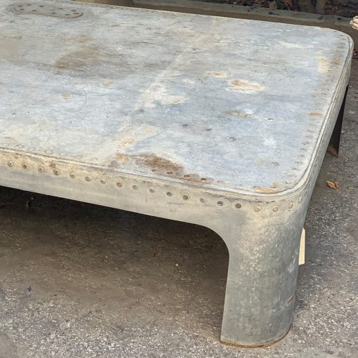 Antique galvanized metal coffee table, top right angle