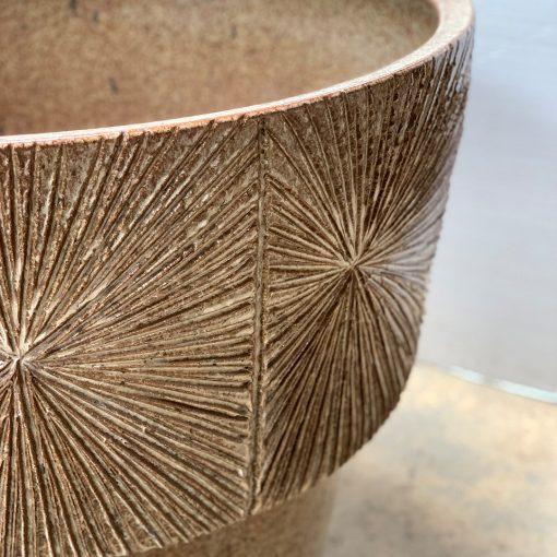 Earthgender sunburst pottery planter, top-right detail