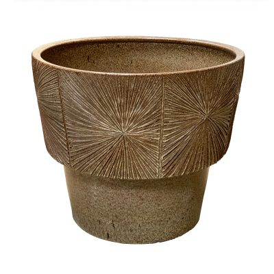 Brown-speckled Earthgender sunburst pottery planter from mid century modern era