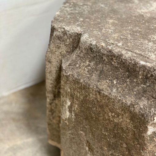 Carved stone garden table, left edge