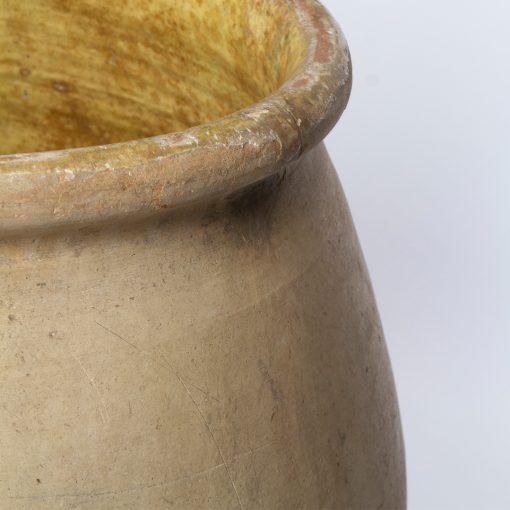 Right side of antique terra cotta drip glaze pottery planter