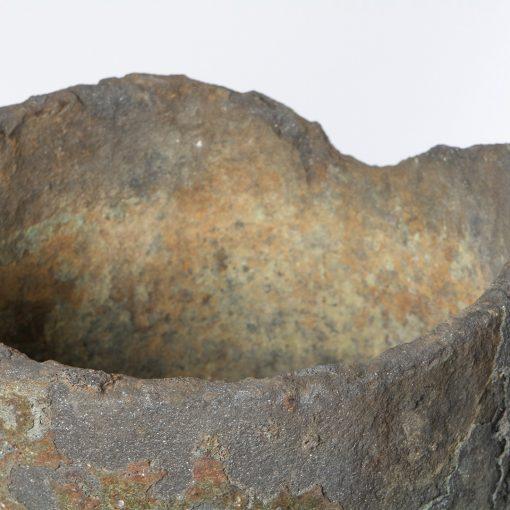 Top edge of vintage garden planter pot made of copper slag