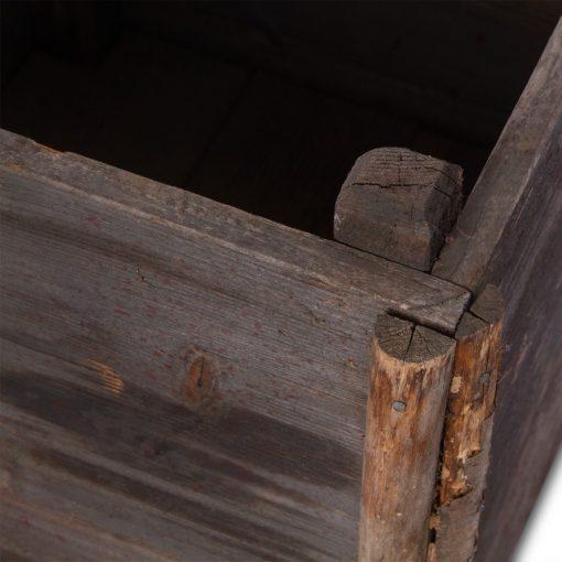Corner of grey tree planter box