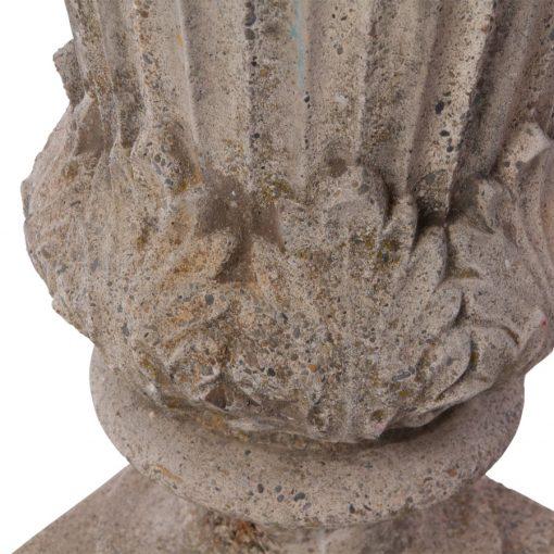 Closeup of concrete tulip motif of concrete urn