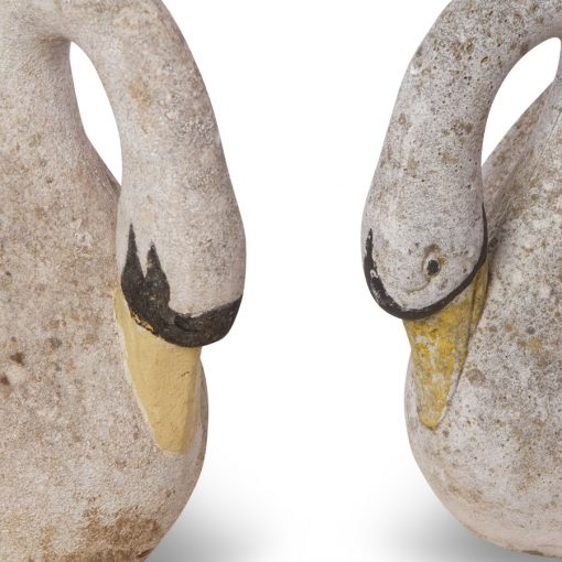 Closeup of 2 swan cement statues facing each other