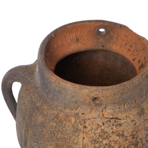 Etched pattern along inner rim of antique terra cotta flower pot